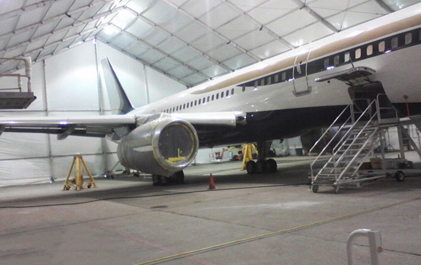 AOG jet airliner inside TFS fabric aircraft hangar for service