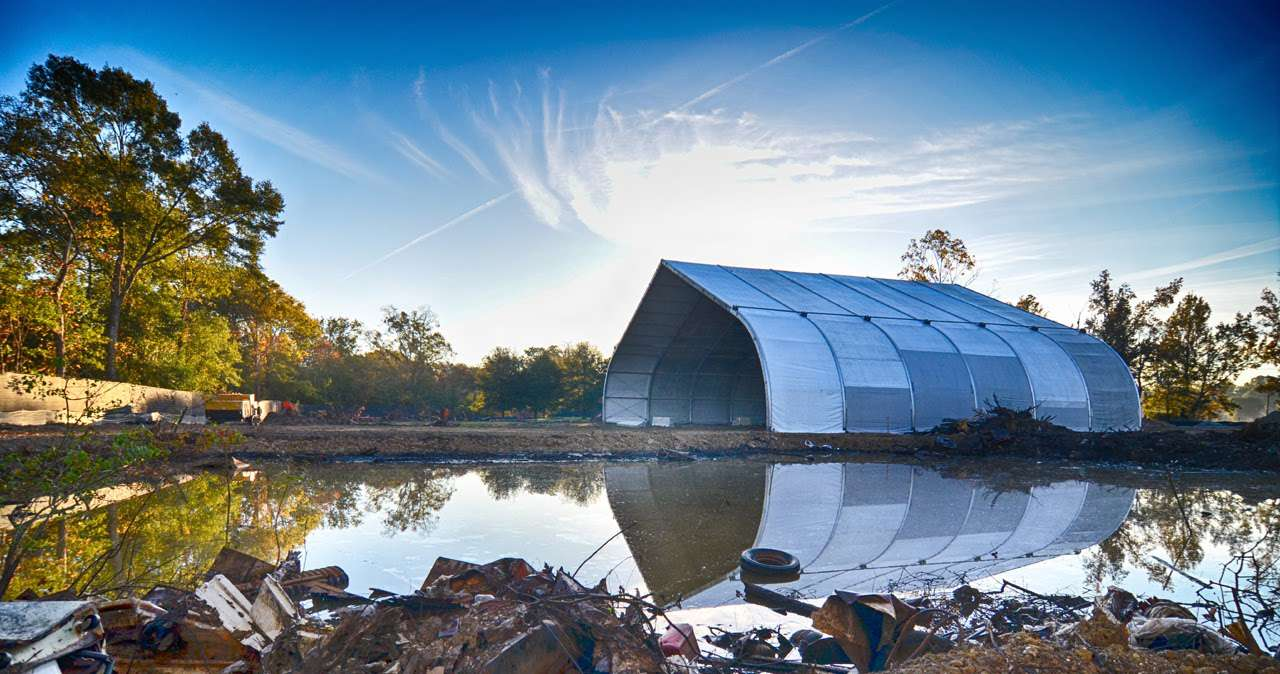 Green remediation fabric structure over environmental remediation field