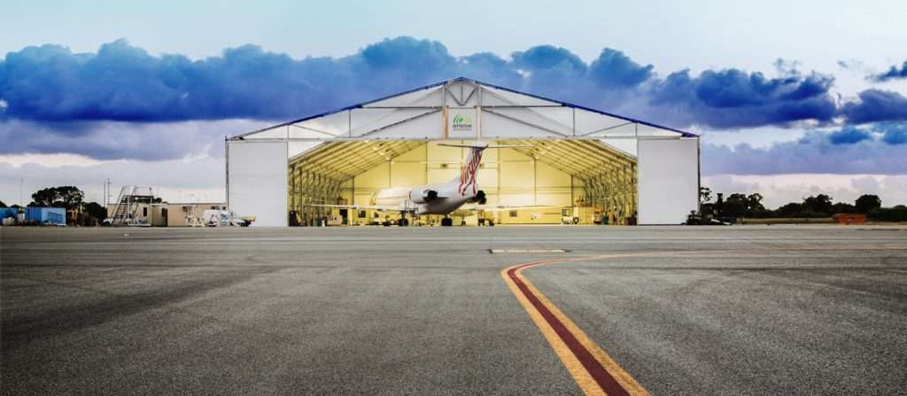 temporary aircraft hangar virgin airlines uses Allsite open ended hangar lit at sunset