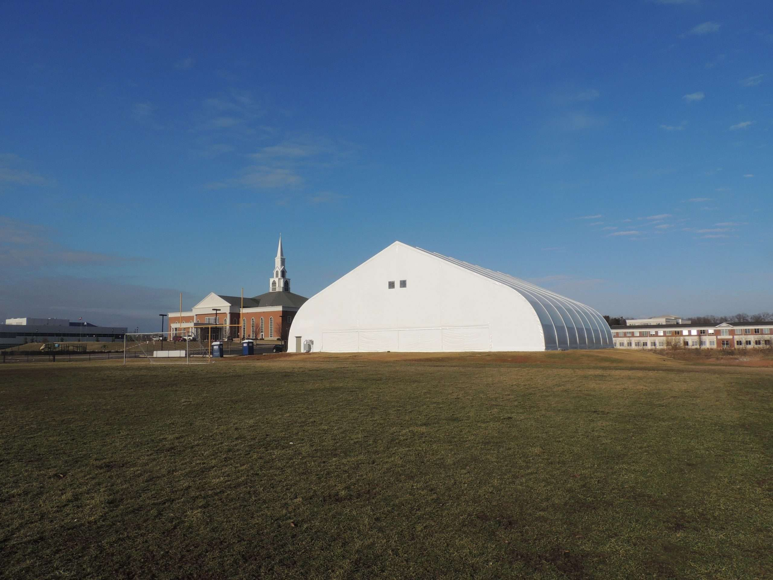 temporary fabric church building next to a church building for holding special church events