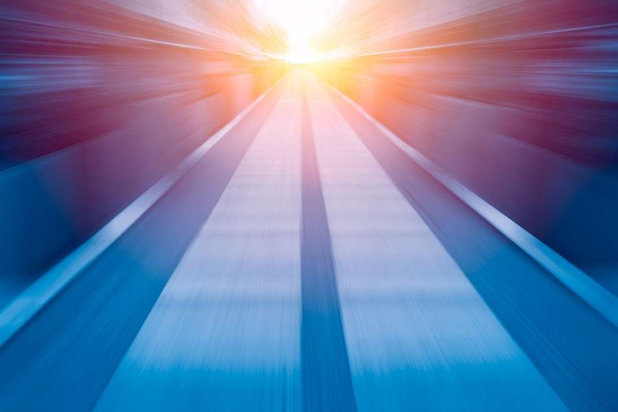 Graphic depicting underground tunnel bright light at the end symbolizing futuristic hyperloop technology