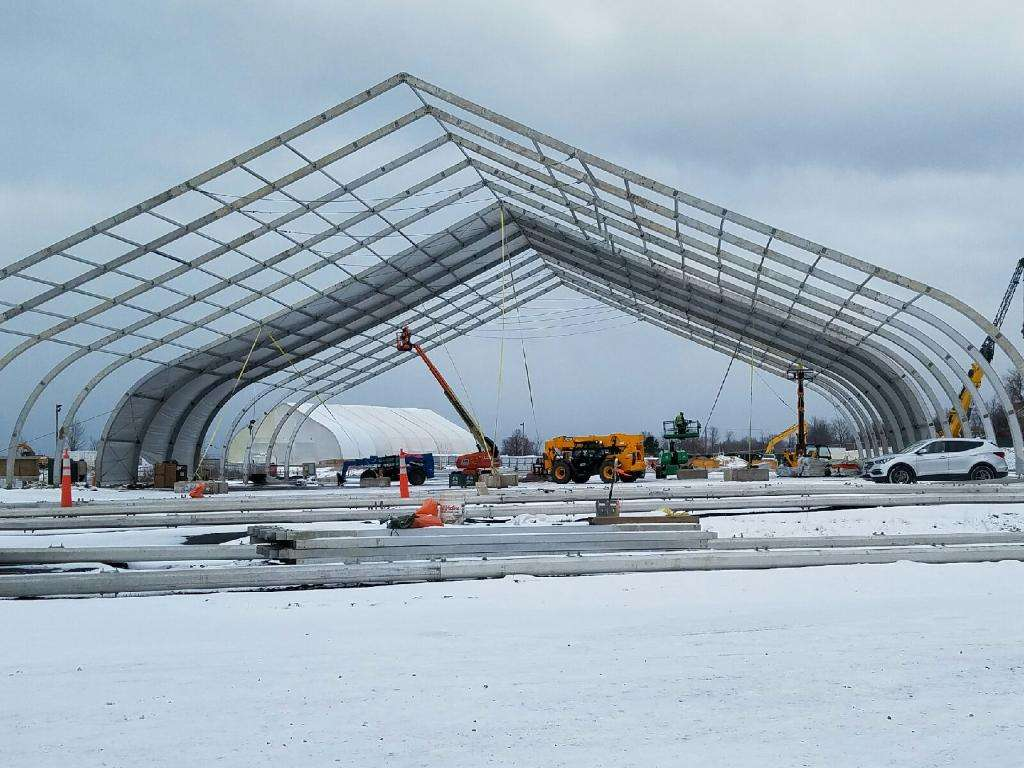 Remediation site structure tension fabric building being erected in winter snow on Great Lakes