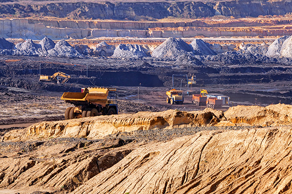 Mining trucks extracting minerals on surface mine in Nevada