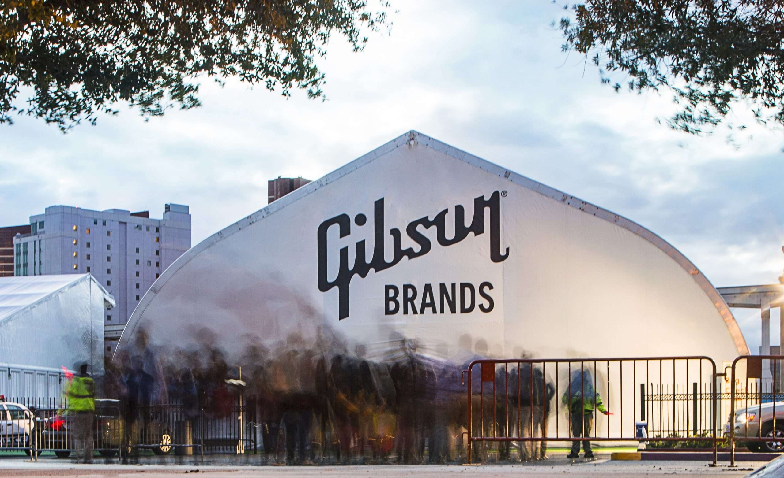 Gibson Guitar tent at CES 2018 with a crowd of visitors at the tension fabric building entrance