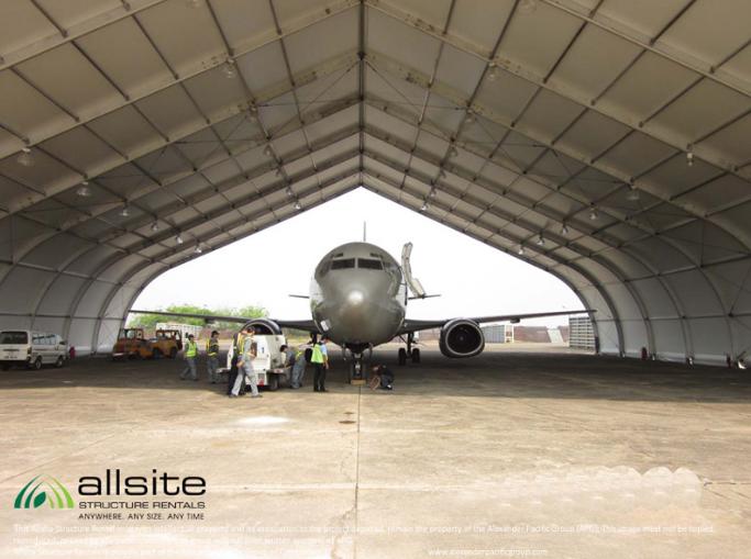 Allsite Fabric Aircraft Hangar interior with jet aircraft and work crews inside