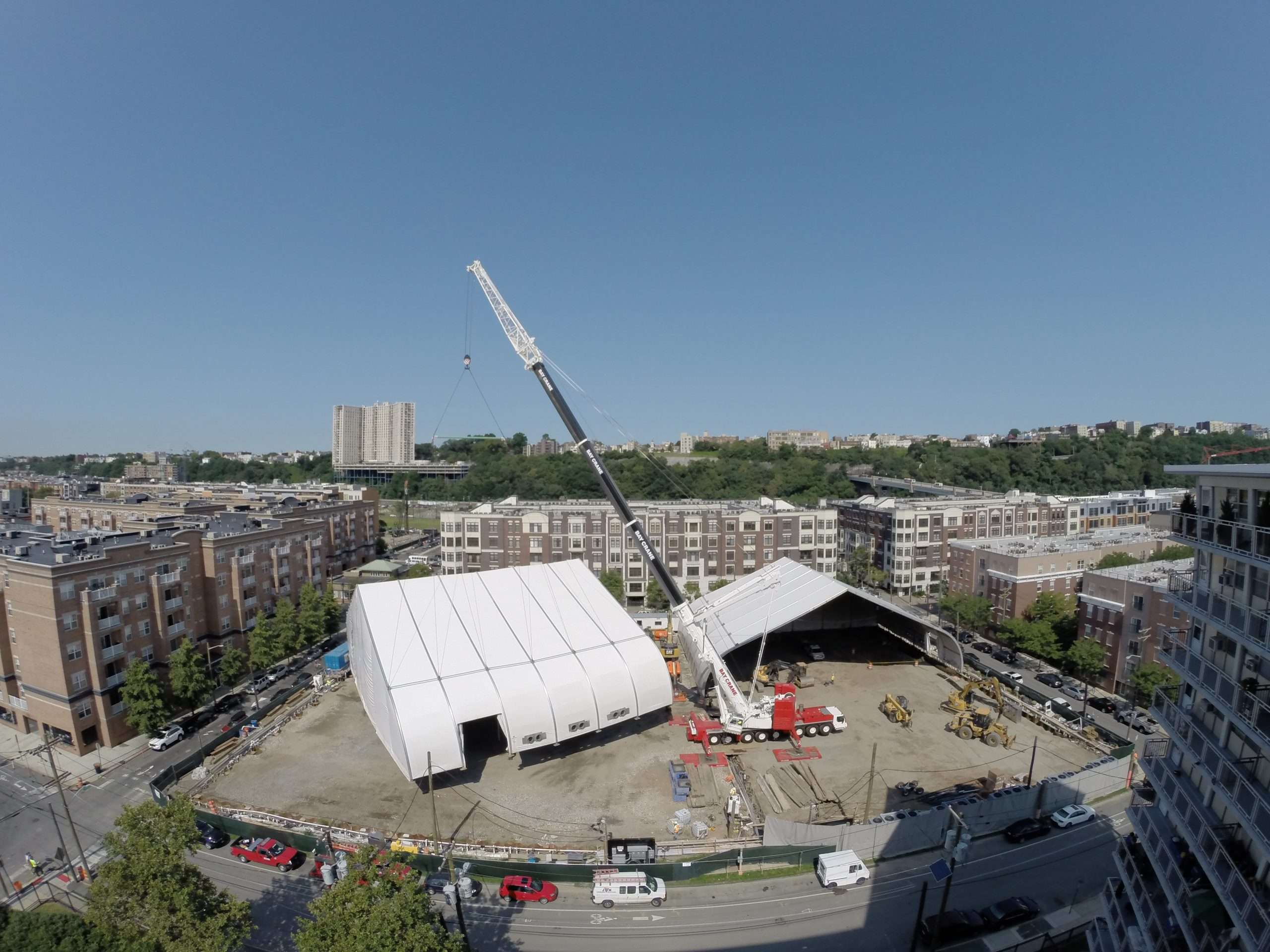 fabric building being lifted and relocated by crane lift at an industrial site in New Jersey