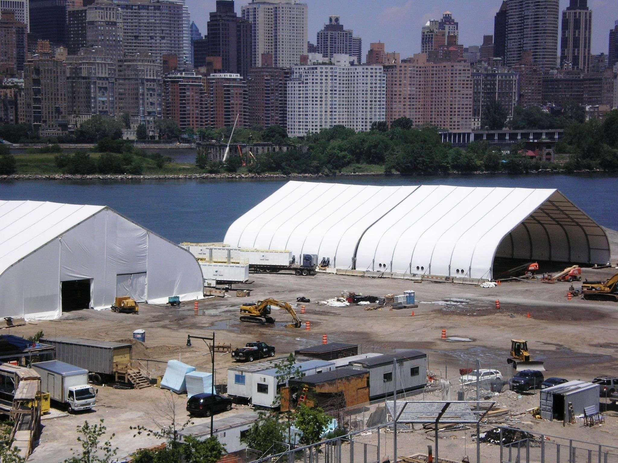 Environmental remediation site in New York Harbor using green remediation fabric structure as temporary project enclosure at water's edge