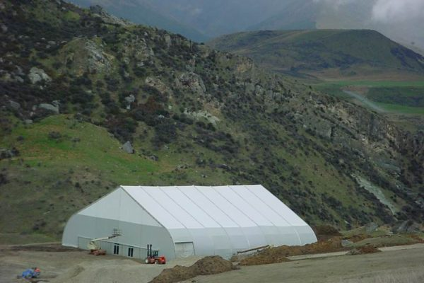 Tension fabric structure in remote mountainous valley at a mining site