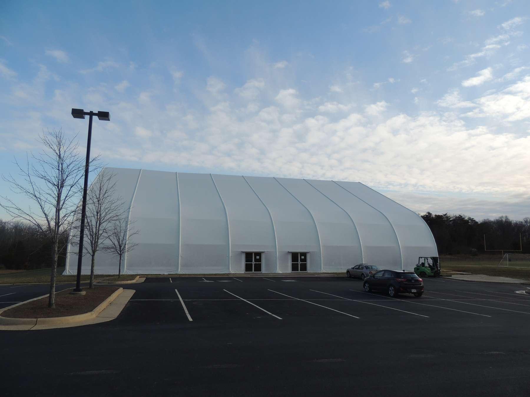 Fabric building on parking lot exterior shot