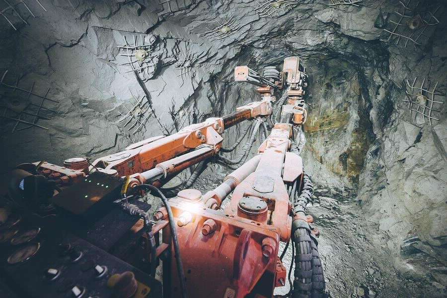 Deep mine drilling equipment excavating gold ore from roc