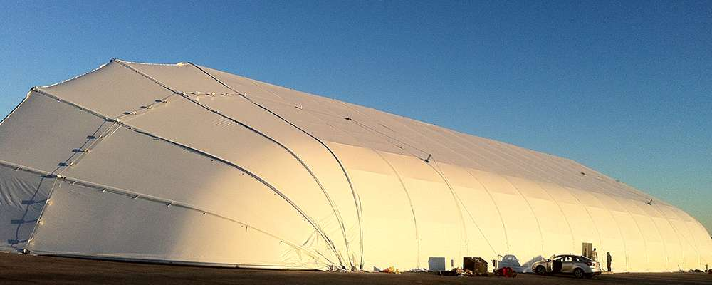 tension fabric aircraft hangar with clamshell door