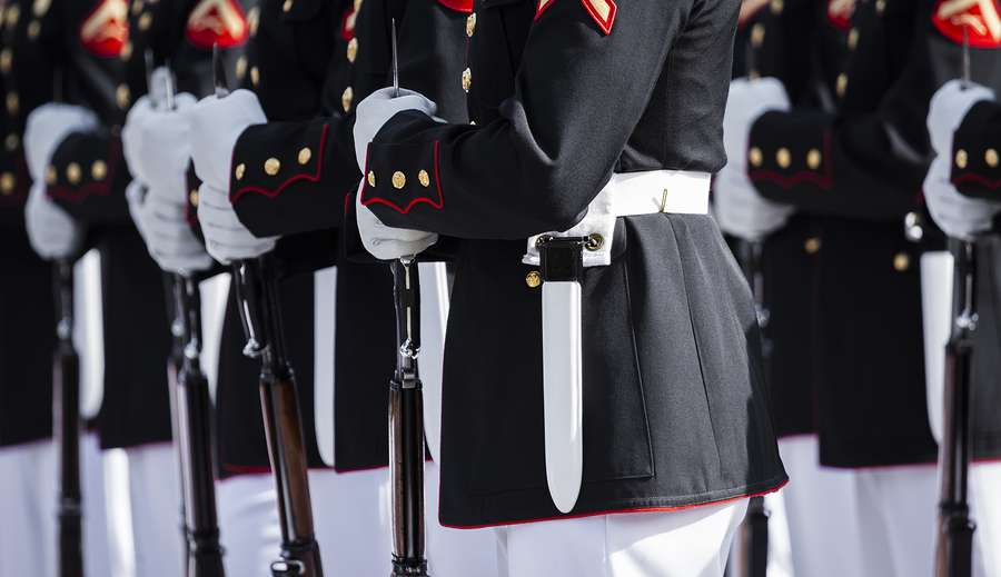 United States Marine Corps members in formal dress at attention