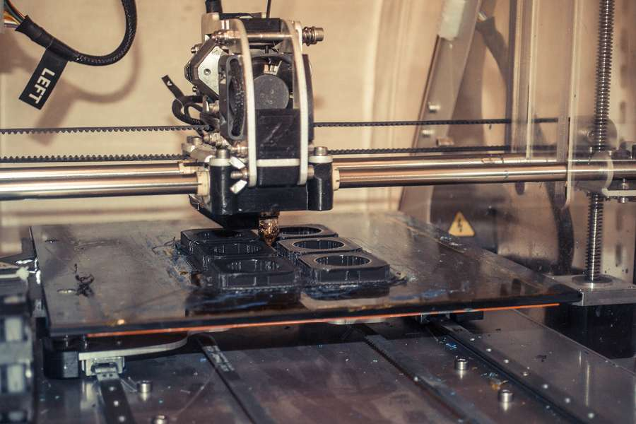 3-d printer used to create spare equipment parts in laboratory