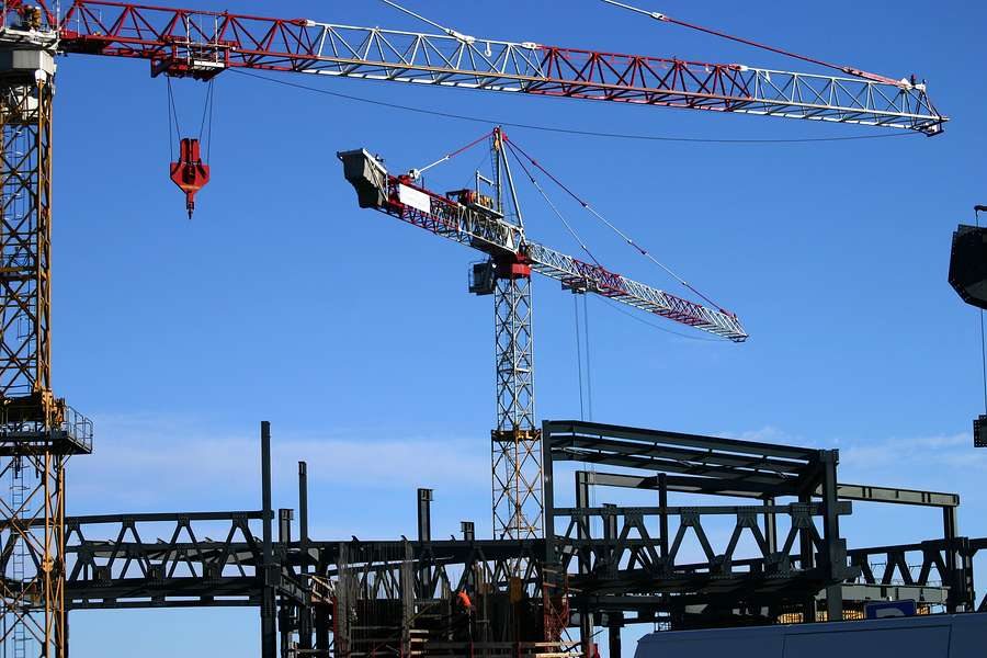 construction site including steel structure and crane