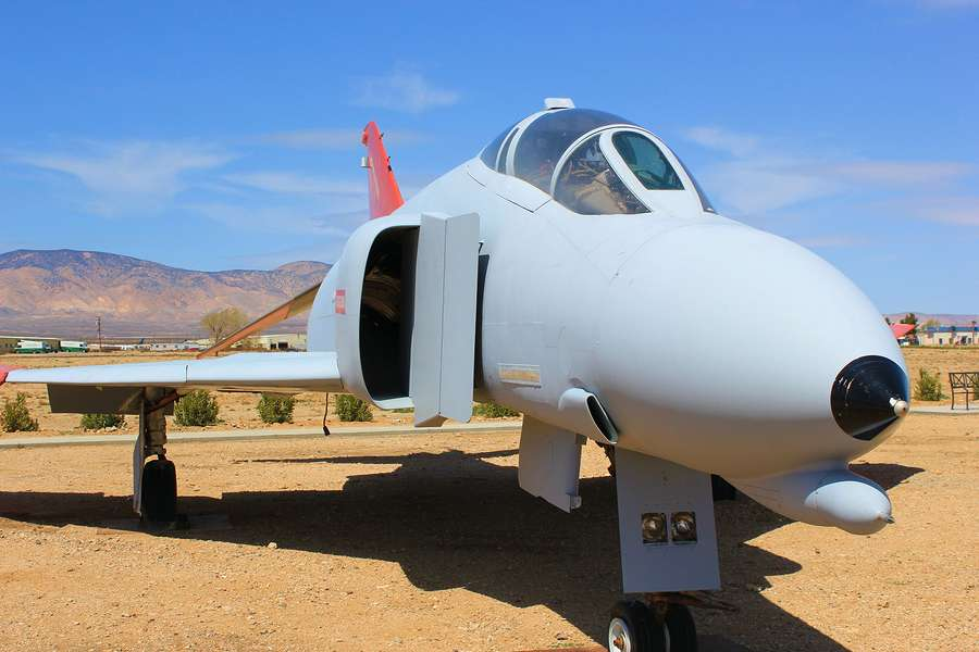 Retired military fighter aircraft on display in aircraft boneyard in the Mojave Desert, CA