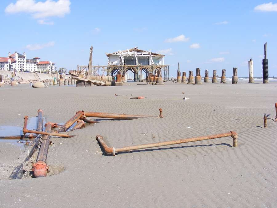 Beach natural disaster area with restaurant and pilings that need to be rebuilt
