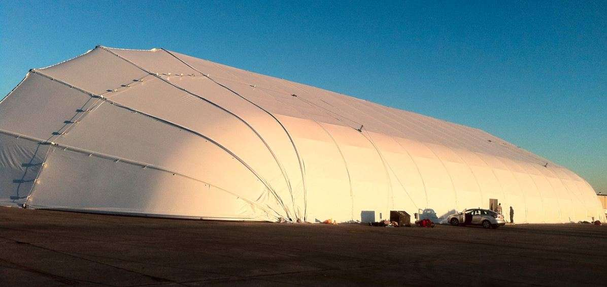 fabric building with clamshell doors for aviation application