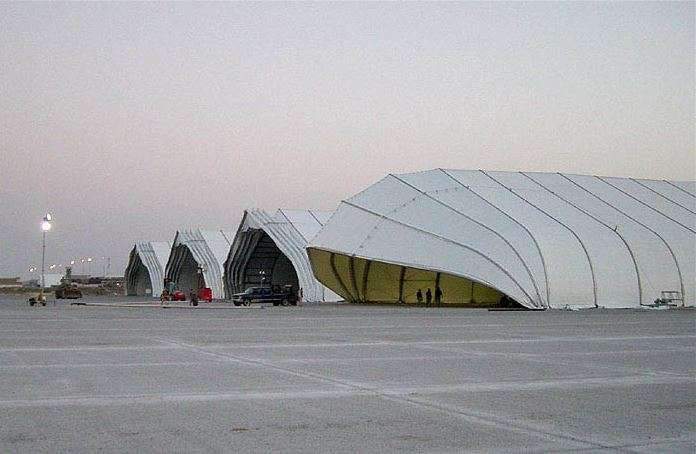 Rpw pf clamshell aviation hangars on airport tarmac