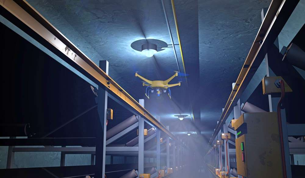 Drone flying through underground mine shaft representing new technology developments in mining industry