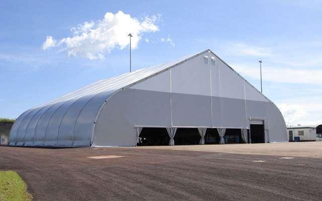 Allsite fabric structure with open bay doors and retractable cargo door