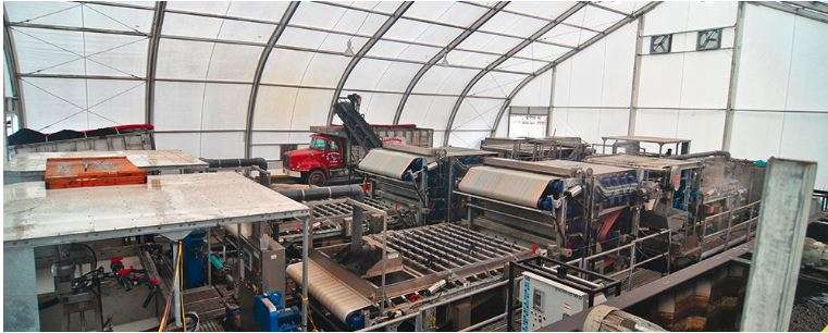 industrial workshop housed in a tension fabric structure