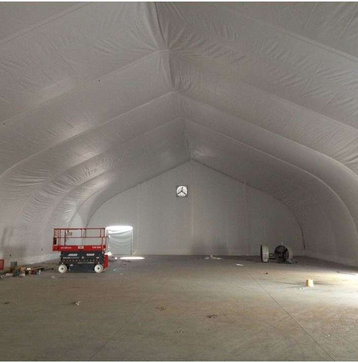 fabric structure interior with liner for enviromental and climate control of interior space