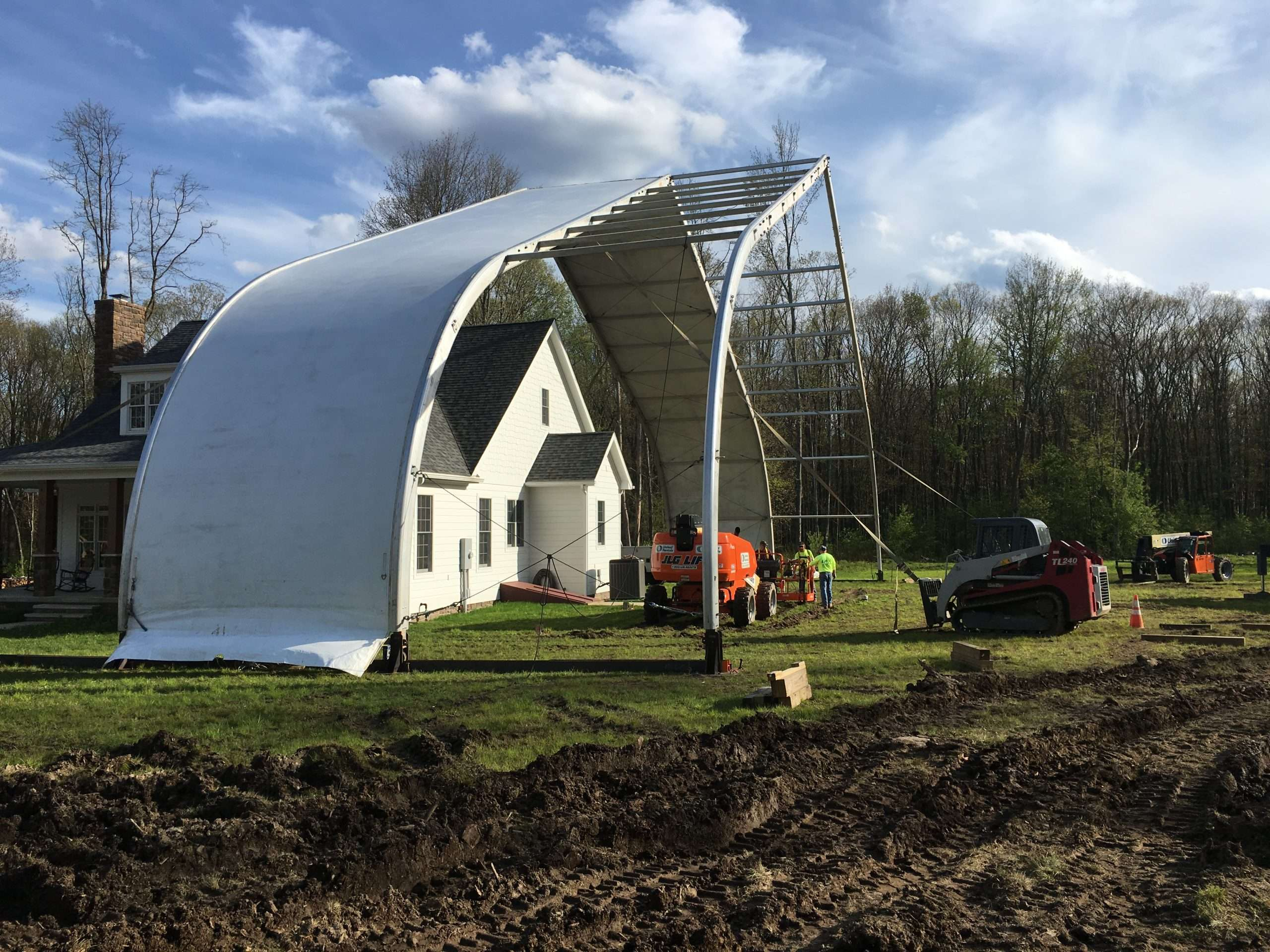 tension fabric and aluminum frame structure over home reconstruction site