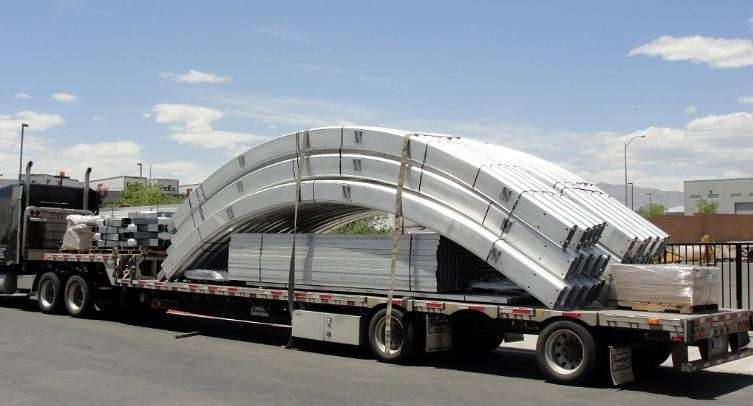 Aluminum frame for tension fabric structure on shipping truck