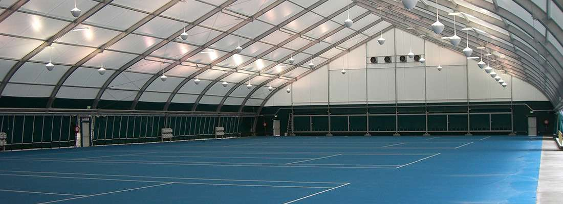 Indoor tennis court in a fabric building structure