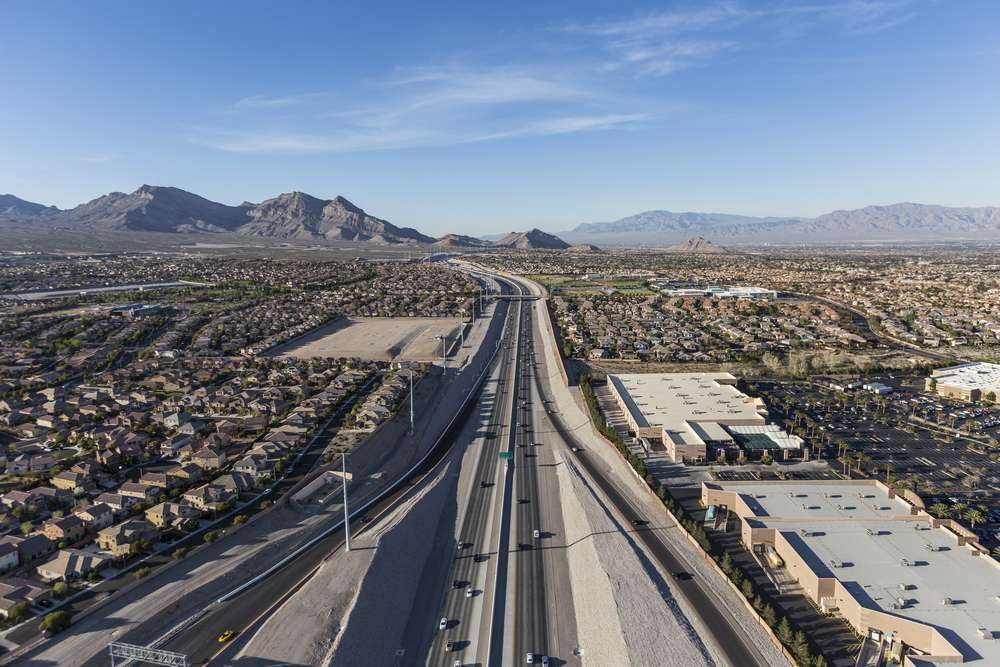 aerial view of 215 beltway over Summerlin neighborhood and new baseball stadium in Las Vegas Nevada