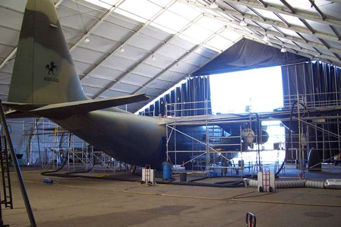 Allsite fabric aircraft hangar with refurbished aircraft in storage