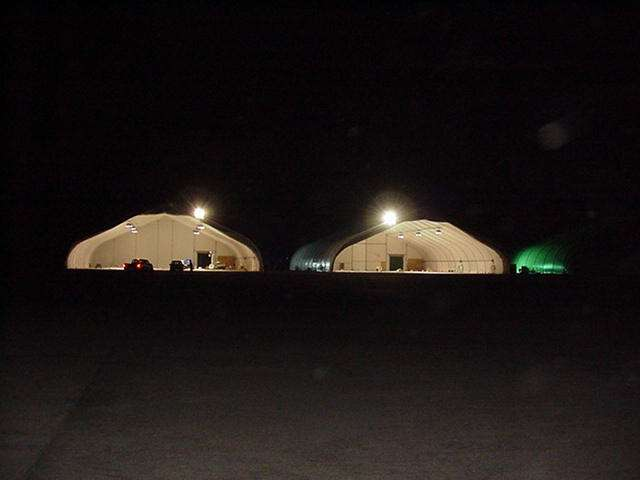 fabric aircraft hangars at night open ended and interior lighting