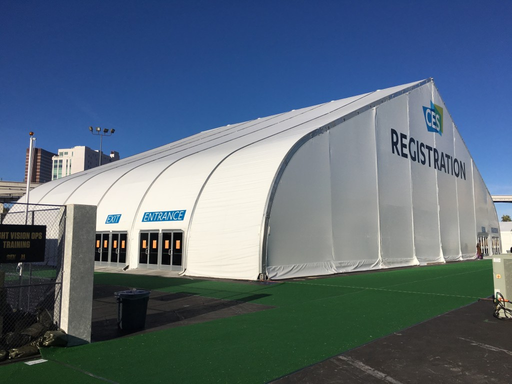 Exterior view of Allsite tension fabric building used as CES Registration at Las Vegas Convention Center in the parking lot with multiple public entry doors
