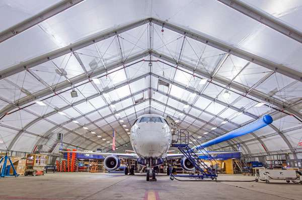 Embrear Air aircraft storage hangar interior with large aircraft inside high clearance aluminum framed fabric structure