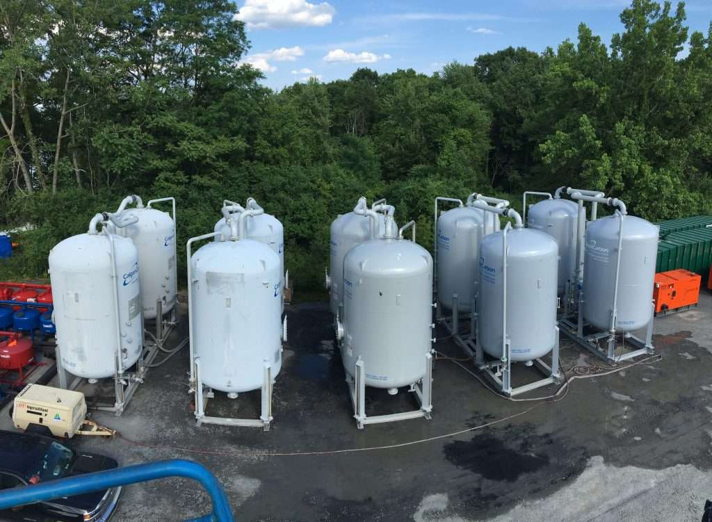 Water contamination clean up tanks filtering drinking water for New York community