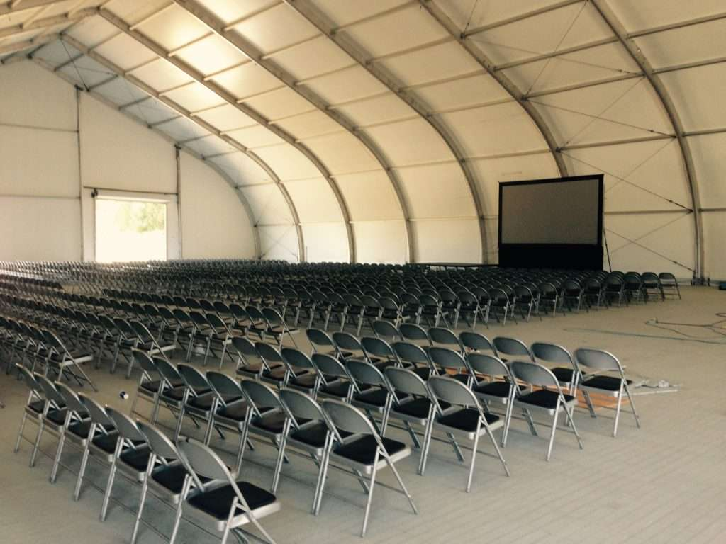 Temporary tension fabric school building interior set up for video presentation with ample student seating