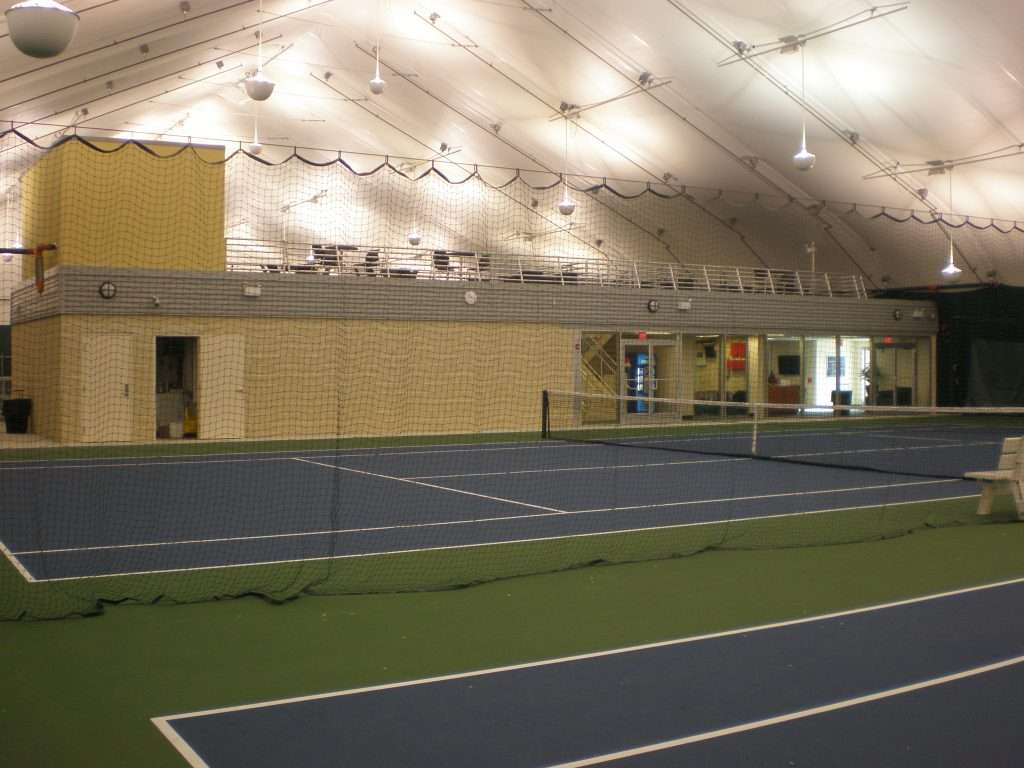 View of Tension Fabric Building interior of tennis center with observation deck, lighting and ticket office space
