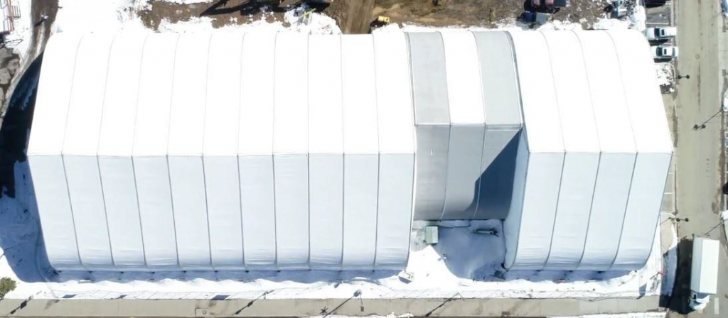 helicopter view of temporary fabric building